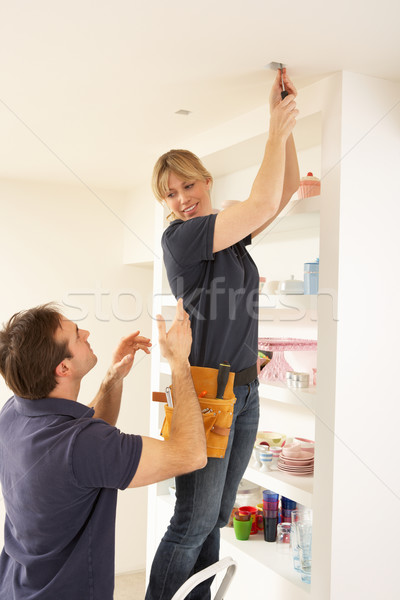 Stock photo: Electrician Teaching Apprentice To Install Light Fitting In Home