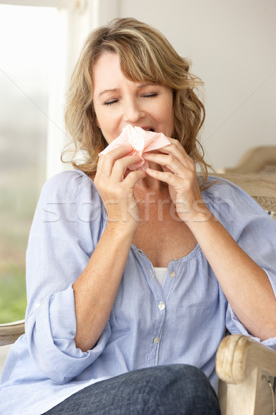 Mid age woman sneezing Stock photo © monkey_business
