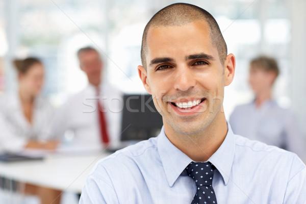 Fiatal üzletember üzlet boldog munka dolgozik Stock fotó © monkey_business