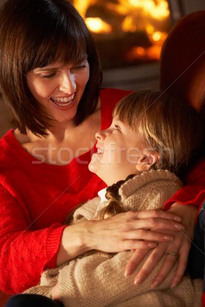 Madre figlia rilassante divano accogliente fuoco Foto d'archivio © monkey_business