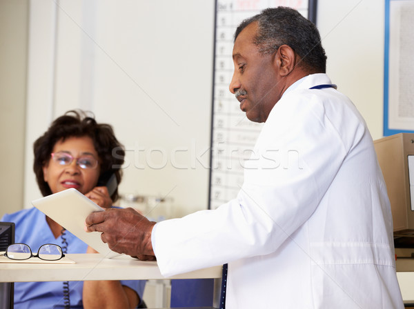 Doctor In Discussion With Nurse At Nurses Station Stock photo © monkey_business
