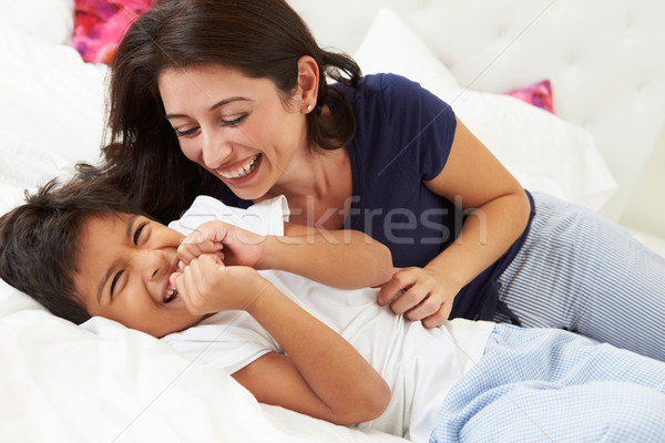 Mother And Son Lying In Bed Together Stock photo © monkey_business