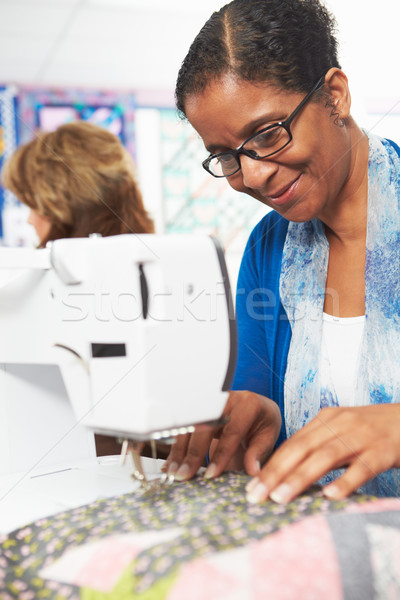 Woman Using Electric Sewing Machine Stock photo © monkey_business