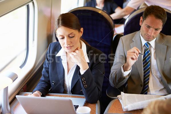 üzletasszony ingázás munka vonat laptopot használ nők Stock fotó © monkey_business
