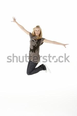 Jeune fille air enfants enfant studio sautant Photo stock © monkey_business