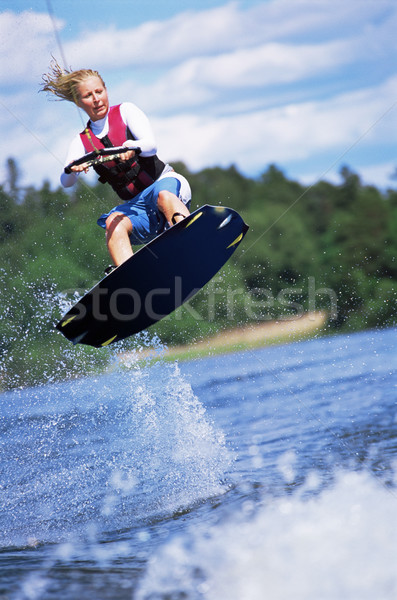 Fiatal nő víz síel tenger szín spray Stock fotó © monkey_business