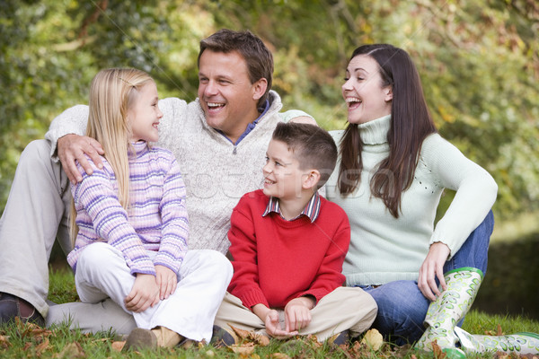 Family relaxing in autumn woodlands Stock photo © monkey_business