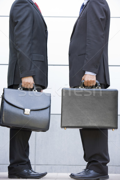 Two businessmen holding briefcases outdoors Stock photo © monkey_business