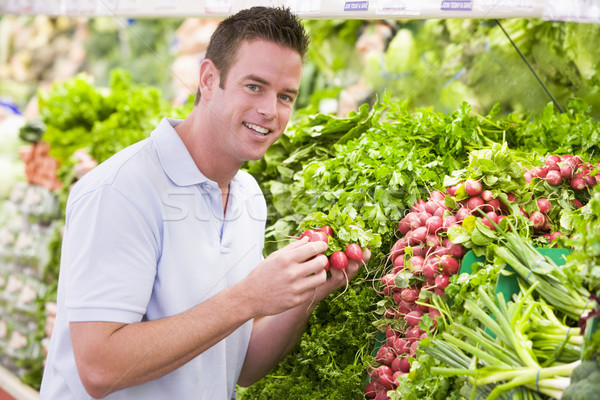 Young man shopping for fresh produce Stock photo © monkey_business