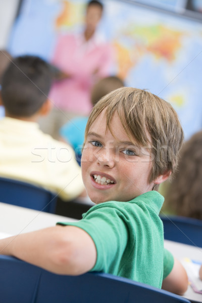 Elementary school pupil in classroom Stock photo © monkey_business