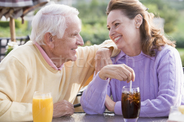 Couple Enjoying A Beverage By A Golf Course Stock photo © monkey_business