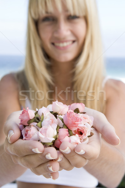 Woman holding handful of flower buds Stock photo © monkey_business