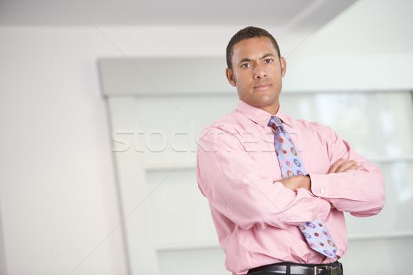 Zakenman permanente binnenshuis business man gelukkig Stockfoto © monkey_business