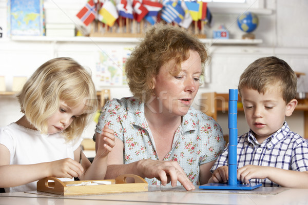Adult Helping Two Young Children at Montessori/Pre-School Stock photo © monkey_business