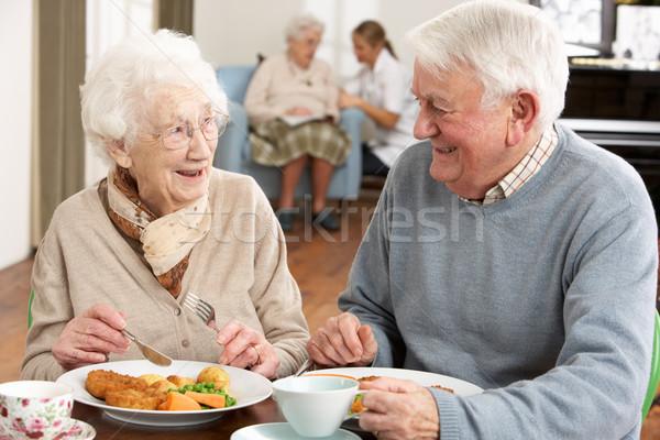 Casal de idosos refeição juntos homem alimentação Foto stock © monkey_business
