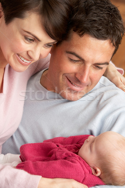 Portrait Of Proud Parents With Newborn Baby At Home Stock photo © monkey_business