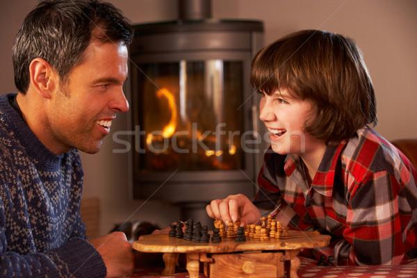 Figlio di padre giocare scacchi accogliente fuoco uomo Foto d'archivio © monkey_business