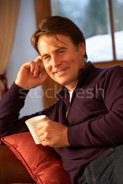Détente boisson chaude canapé homme café Photo stock © monkey_business