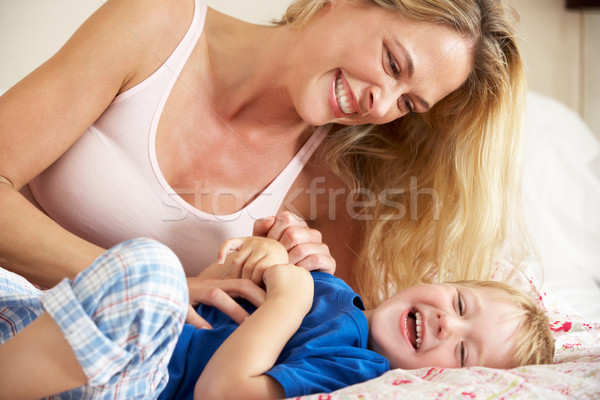Mother And Son Relaxing Together In Bed Stock photo © monkey_business