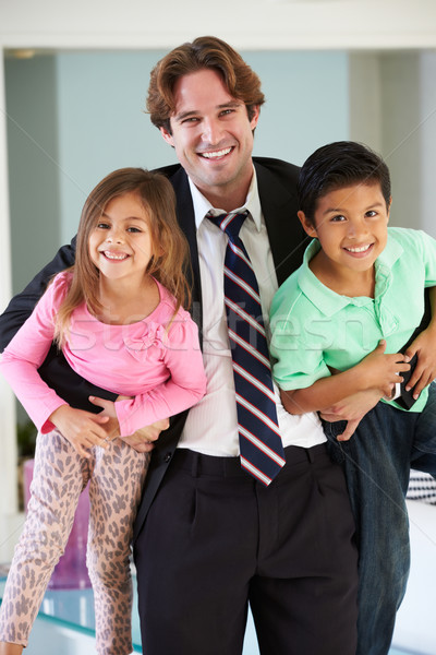 Children Greeting Father On Return From Work Stock photo © monkey_business