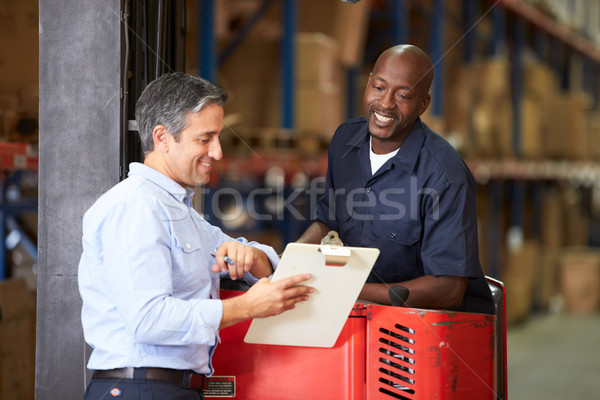Fork Lift Truck Operator Talking To Manager In Warehouse Stock photo © monkey_business
