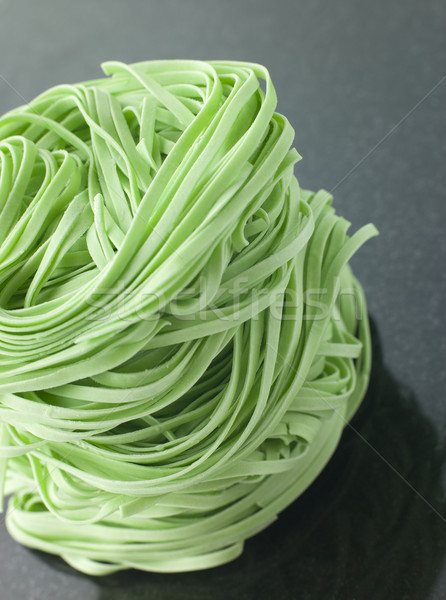 Stack of Spinach Noodles on a Black Background Stock photo © monkey_business