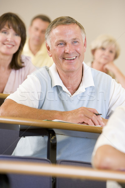 Stock photo: Senior man listening to a university lecture