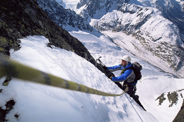 Fiatal férfiak hegymászás csúcs hó mászik szín Stock fotó © monkey_business