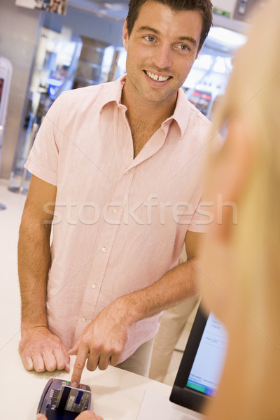 Man entering security details for credit card transaction Stock photo © monkey_business
