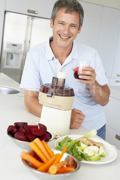 Middle Aged Man Making Fresh Vegetable Juice Stock photo © monkey_business