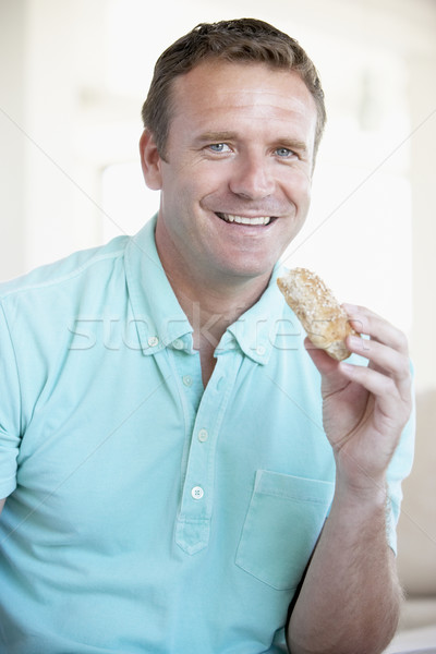 Mid Adult Man Eating Brown Bread Roll Stock photo © monkey_business