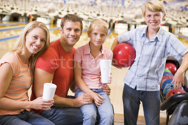 Family in bowling alley with drinks smiling Stock photo © monkey_business