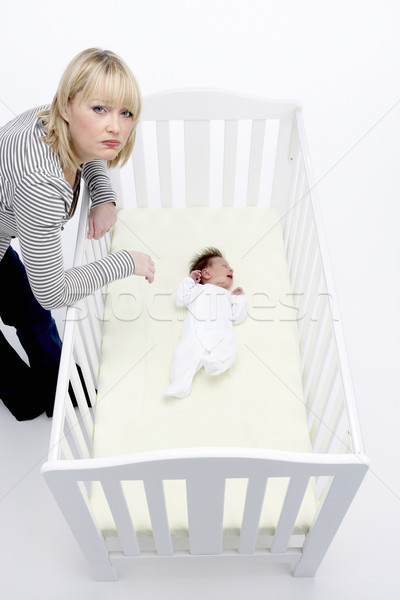Stressed Mother Looking At Baby In Cot Stock photo © monkey_business