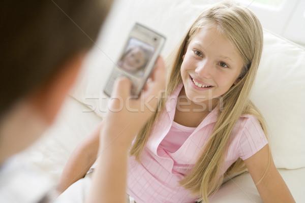 Quadro sorridente jovem câmera Foto stock © monkey_business