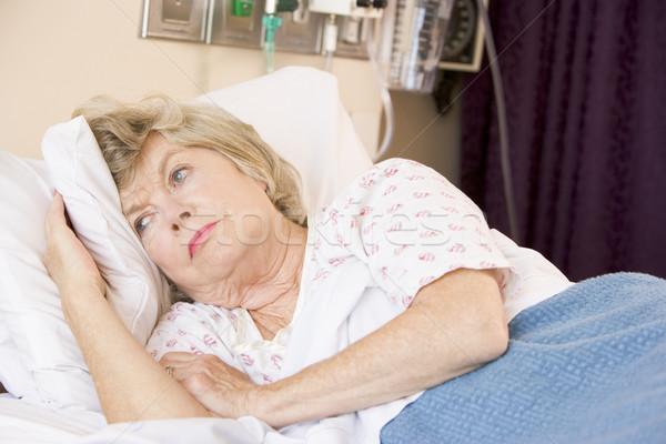 Idős nő kórházi ágy kórház szomorú beteg Stock fotó © monkey_business
