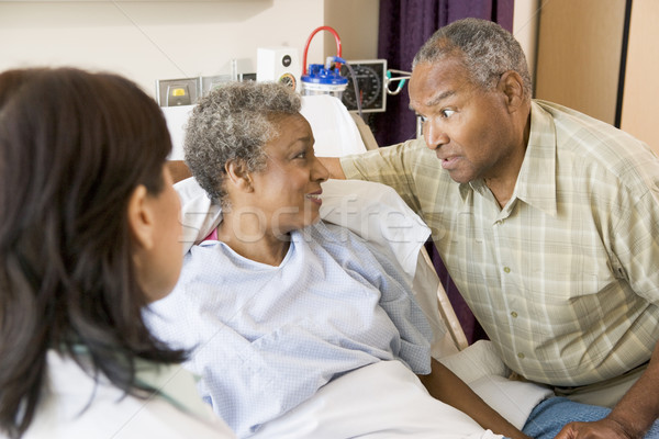 Stock photo: Doctor Explaining,Senior Couple Looking At Each Other