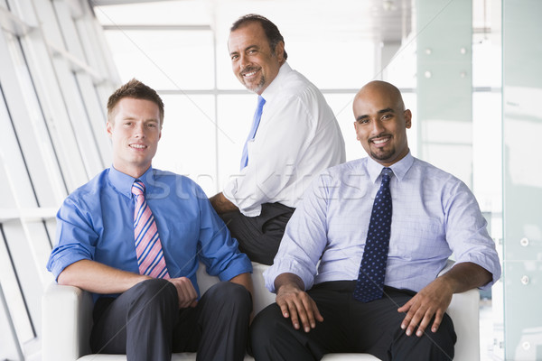 Group of businessmen sitting in lobby Stock photo © monkey_business