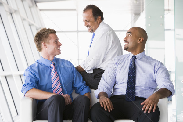 Group of businessmen talking in lobby Stock photo © monkey_business