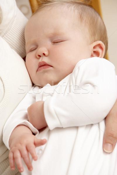 Mother Holding Sleeping Baby In Nursery Stock photo © monkey_business
