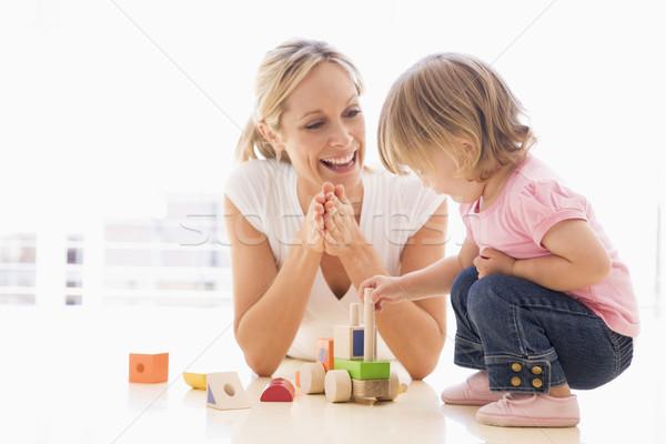 Anya lánygyermek bent játszik mosolyog lány Stock fotó © monkey_business