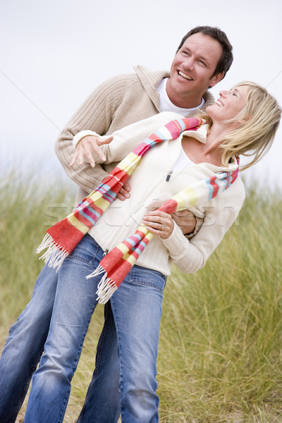 Stock photo: Couple standing on beach smiling