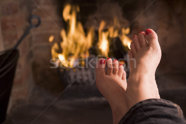 Feet warming at a fireplace Stock photo © monkey_business
