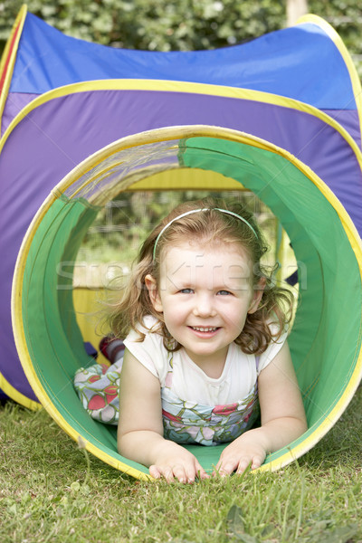 Young Girl Crawling Through Play Equipment Stock photo © monkey_business