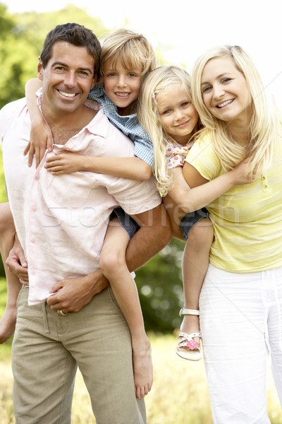 Stock photo: Family having fun in countryside