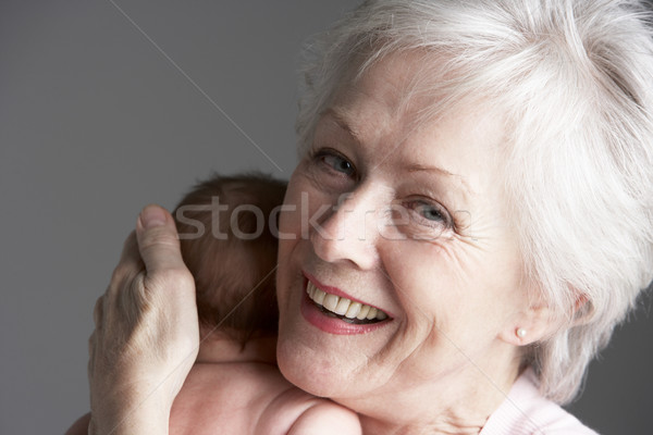 Studio Shot Of Grandmother Cuddling Granddaughter Stock photo © monkey_business