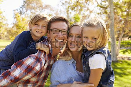 Family Group Outdoors In Autumn Landscape With Parents Giving Ch Stock photo © monkey_business