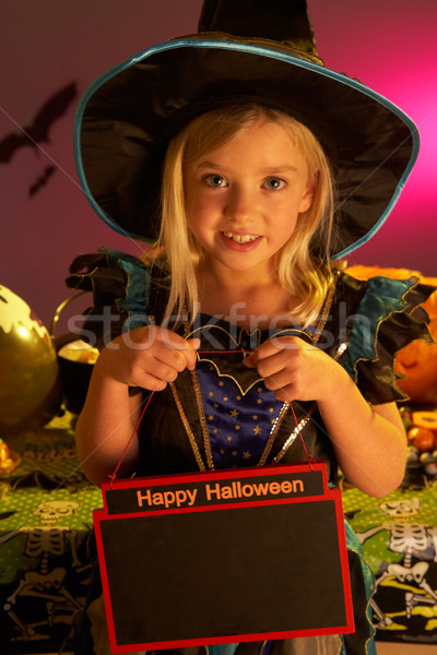 Halloween party with a child holding sign Stock photo © monkey_business