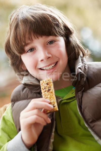 Ragazzo mangiare sano bar indossare inverno Foto d'archivio © monkey_business