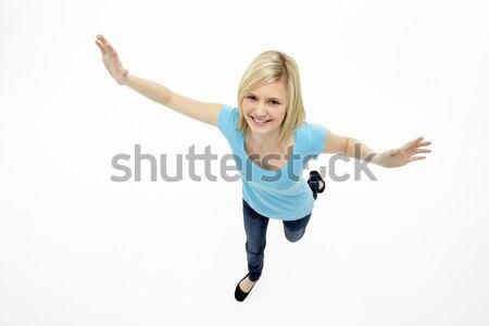 Stok fotoğraf: Genç · kız · ayakta · stüdyo · çocuklar · mutlu · çocuk