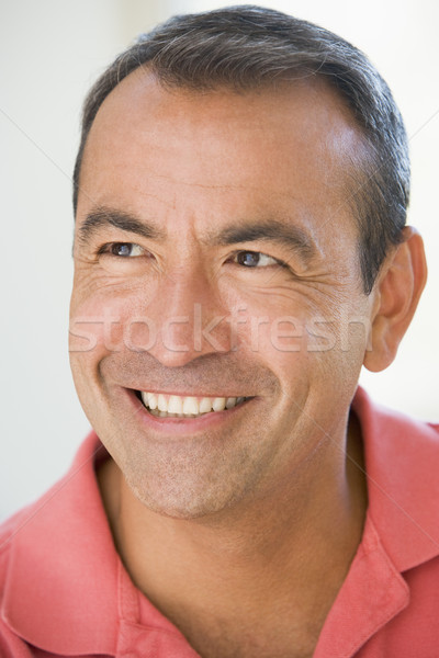 Stock photo: Head shot of man smiling